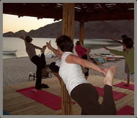 baja wellness retreat beachside yoga